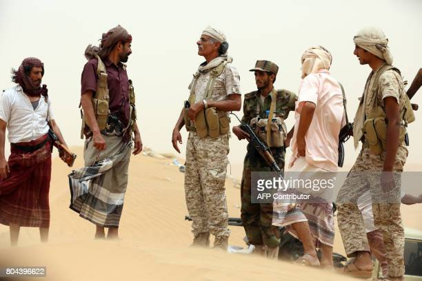 Yemeni tribesmen from the Popular Resistance Committees supporting forces loyal to Yemen's Saudibacked President gather during fighting against...