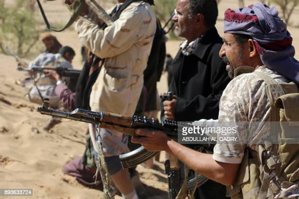 Yemeni tribesmen from the Popular Resistance Committees supporting forces loyal to Yemen's Saudibacked President hold a position during clashes with...