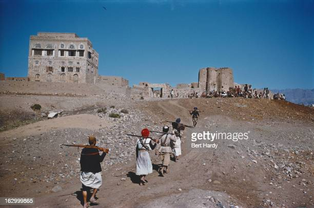 Yemeni tribesmen returning to a fort at Qataba Yemen circa 1957 The men are engaged in an isurgency on behalf of Ahmad bin Yahya King of Yemen...
