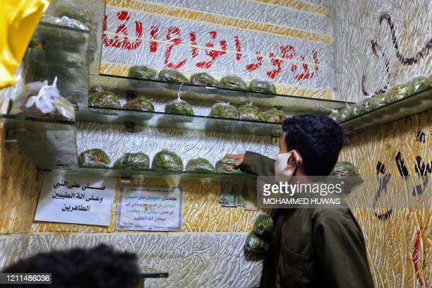 A Yemeni vendor stocks bags of qat the ubiquitous mild narcotic at a market in the capital Sanaa on May 1 2020 While most of the world's markets have...