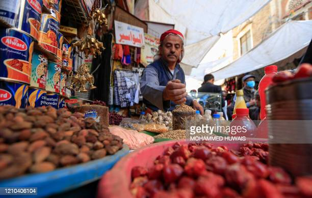 A Yemeni vendor waits for costumers in the old city market of the capital Sanaa ahead of the holy Muslim fasting month of Ramadan on April 18 2020...