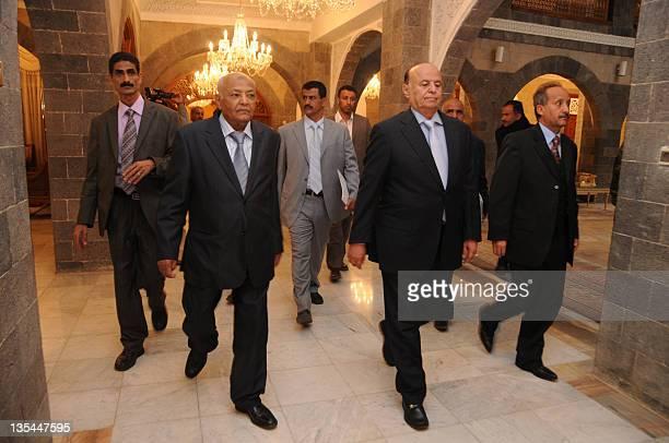 Yemeni Vice President Abdrabuh Mansur Hadi and Prime Minister Mohammed Basindawa arrive at a swearingin ceremony of Yemen's national unity government...