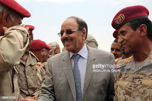 Yemeni Vice President General Ali Mohsen alAhmar shakes hands with army officers as he visits military barracks in the eastern city of Marib on...