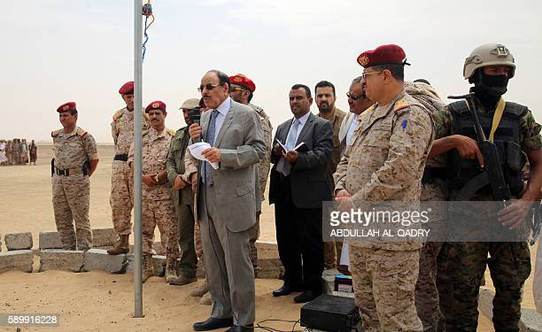 Yemeni Vice President General Ali Mohsen alAhmar uses a microphone to speak as he visits military barracks in the eastern city of Marib on August 15...