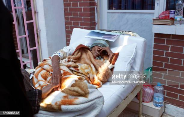 A Yemeni woman suspected of being infected with cholera receives treatment at a hospital in Sanaa on May 6 2017 At least 570 suspected cases of...