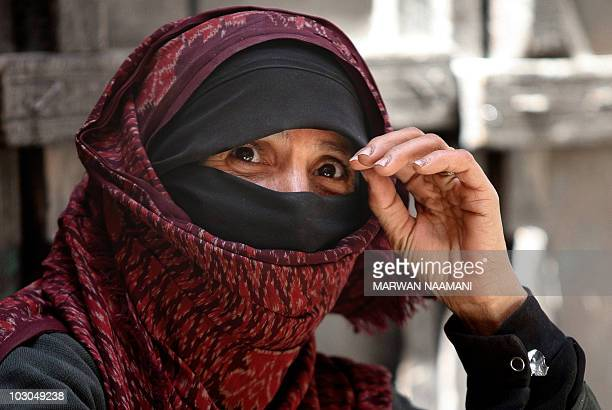 A Yemeni woman vendor waits for customers in the old city of Sanaa on November 8 2009 Declared a World Heritage site by UNESCO in 1984 Sanaa's old...