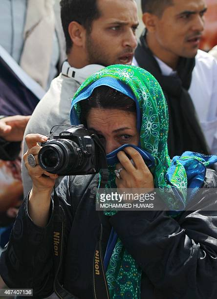 A Yemeni woman weeps during the funeral of awardwinning journalist Abdul Karim alKhiwani who had become top official of the Shiite Huthi militia on...