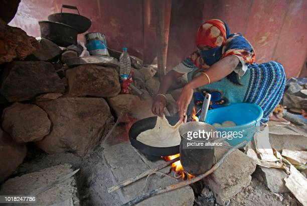 A Yemeni woman who was displaced from the coastal city of Al Hudaydah makes bread at a shelter where she lives with her family in Sanaa Yemen 17...