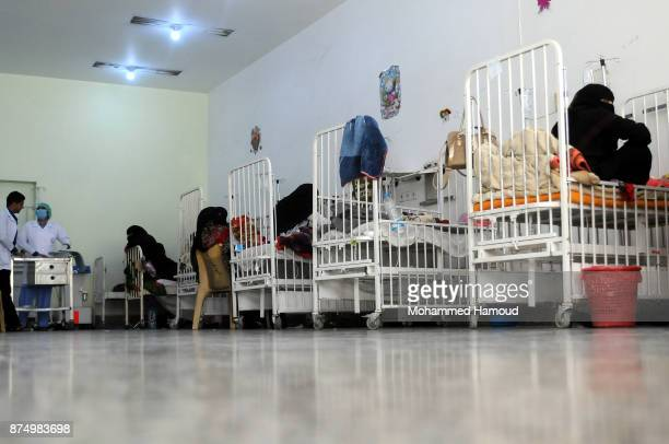 Yemeni women accompany their malnourished children who receive medical treatment amid a spread of malnutrition and risk of famine at a hospital on...