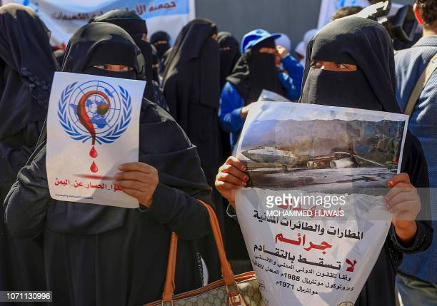Yemeni women demonstrators hold posters denouncing airstrikes on civilian airports and airplanes as they demonstrate outside the United Nations...