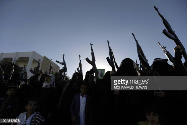 TOPSHOT Yemeni women loyal to the Huthi movement hold up rifles as they attend a gathering to show support to the movement in the capital Sanaa on...