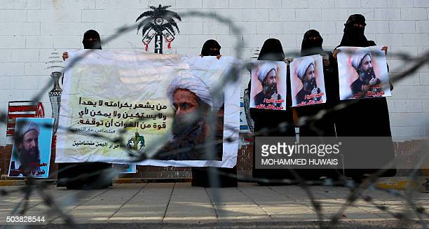 Yemeni women supporters of Iranbacked Shiite Huthi rebels hold banners bearing portraits of prominent Shiite cleric Nimr alNimr during a...