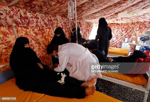 Yemeni women suspected of being infected with cholera receive treatment at Sabaeen Hospital in Sanaa on June 13 2017 Six weeks into the second...