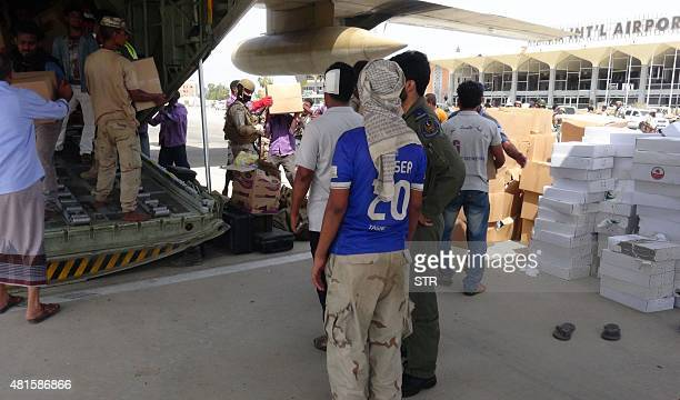 Yemeni workers unload boxes of relief aid from a Saudi military plane at Aden's international airport in Yemen's second city of Aden on July 22 2015...