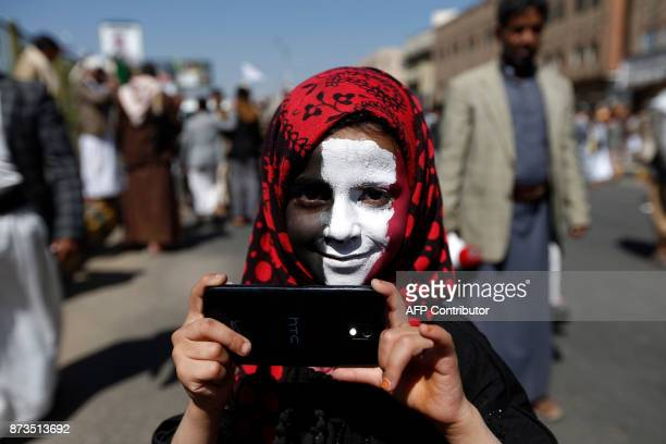 A Yemeni youth takes part in a demonstration calling for the Saudiled coalition's blockade to be lifted on November 13 in the rebelheld capital Sanaa...
