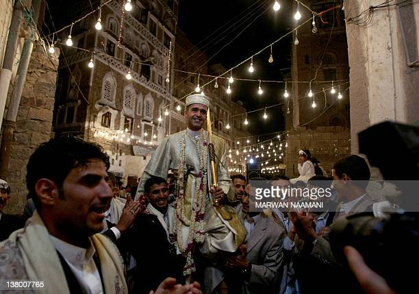 Yemenis attend a relative's wedding in the old city of Sanaa late on October 20 2011 Despite the deadly violence across the country on a daily basis...