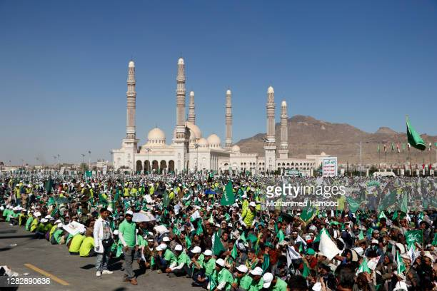 Yemenis attend the annual ceremony commemorating the Birthday of Prophet Muhammad on October 29, 2020 in Sana'a, Yemen.