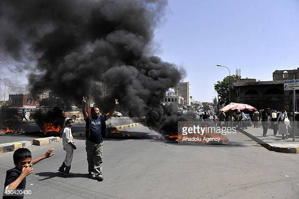 Yemenis burn tyres and block roads to protest the fuel shortage in Yemen that caused long lines of car queues at petrol stations in Sanaa Yemen on...