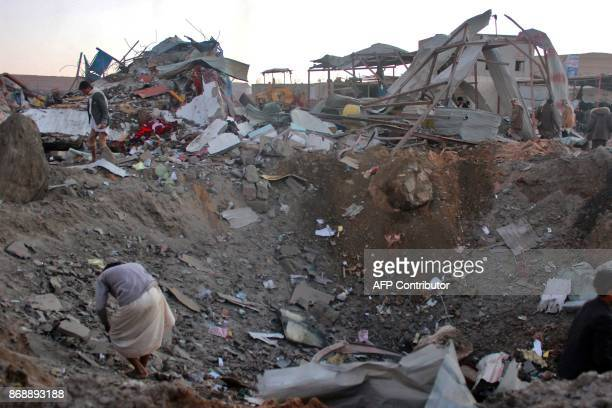 Yemenis check the aftermath of an air strike on the Sahar district of the northern Yemeni governorate of Saada on November 1 2017 The war in Yemen...