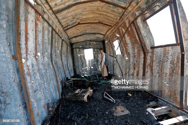 TOPSHOT Yemenis check the damage in a power station in the aftermath of a reported air strike by the Saudiled coalition in the Yemeni capital Sanaa...