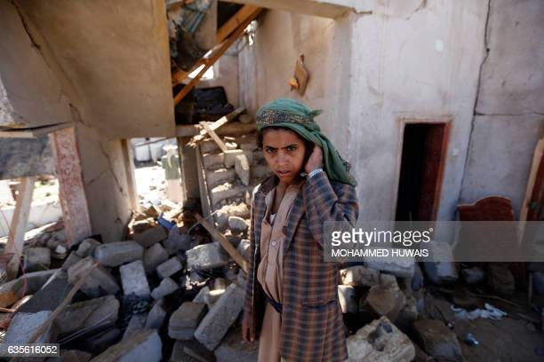 TOPSHOT Yemenis check the site of an air raid that hit a funeral reception in the Arhab district 40 kilometres north of the capital Sanaa on February...