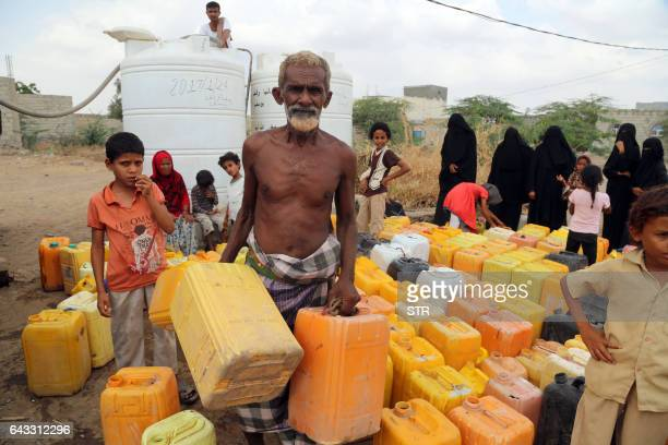 Yemenis collect water from a donated source amid continuing wide spread disruption of water supply in the impoverished coastal village on the...