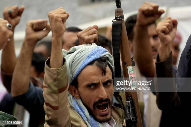 Yemenis demonstrate during a protest against the suspension of aid provided by the World Food Program in front of United Nations' office in the...