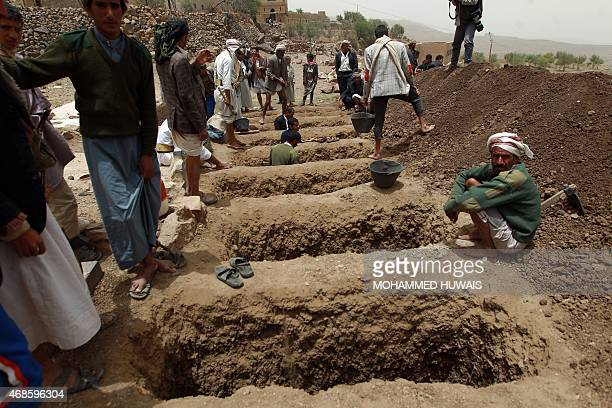 Yemenis dig graves on April 4, 2015 to bury the victims of a reported airstrike by the Saudi-led coalition against Shiite Huthi rebel positions in...