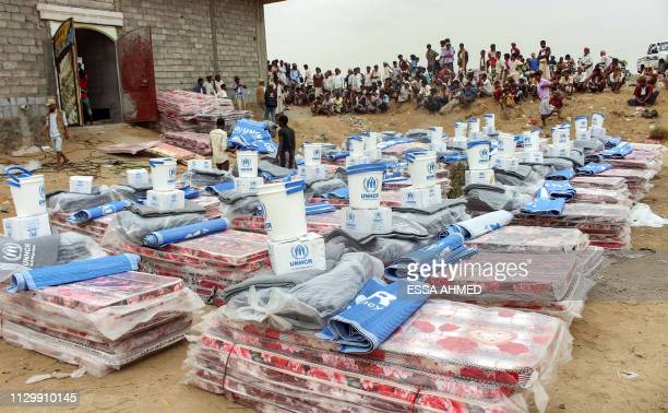 Yemenis displaced from areas near the border with Saudi Arabia receive humanitarian aid given by the Norwegian Refugee Council and the UN High...