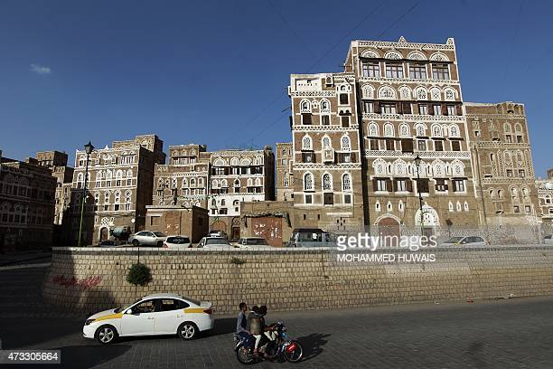 Yemenis drive in the capital Sanaa's old city on May 14 2015 The United Nations calls on all parties to the Yemen conflict to respect a humanitarian...
