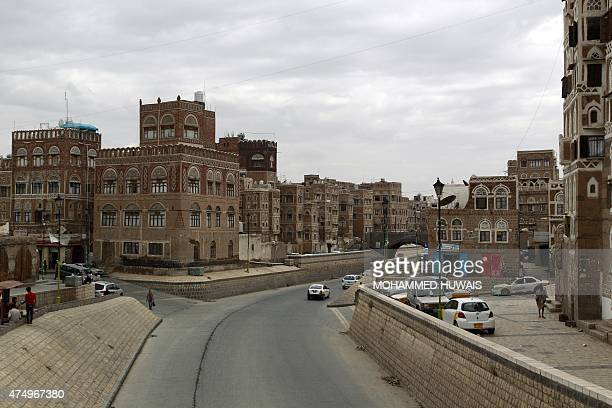 Yemenis drive their cars in the old city of the capital Sanaa on May 28 2015 AFP PHOTO / MOHAMMED HUWAIS