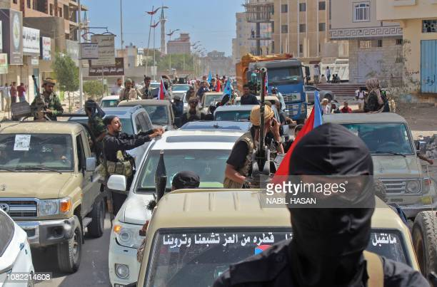 Yemenis drive their vehicles during the funeral procession of Brigadier General Saleh Tamah as it makes its way from alFardous Mosque to the Abu...