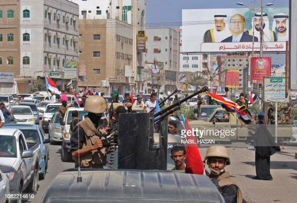 Yemenis drive their vehicles during the funeral procession of Brigadier General Saleh Tamah as it makes its way from al-Fardous Mosque to the Abu...