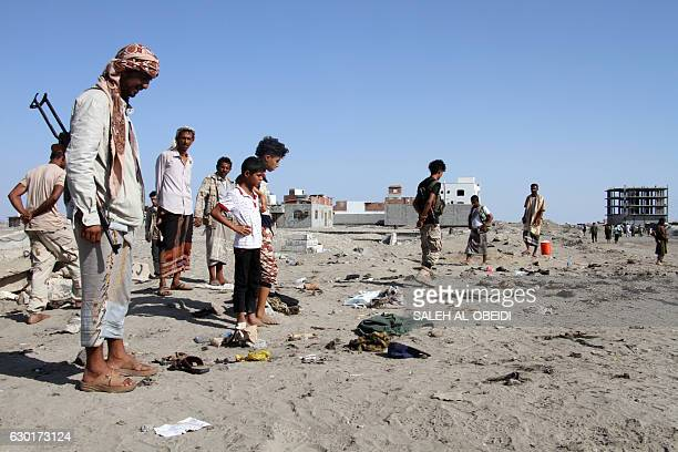 Yemenis gather at alSawlaba base in Aden's alArish district on December 18 after a suicide bomber targeted a crowd of soldiers A suicide bomber...