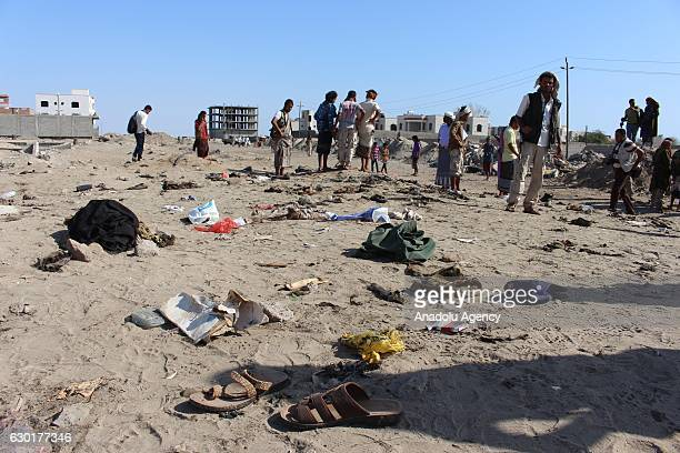 Yemenis gather at Hur Mekser region in Aden on December 18 after a suicide bomber targeted a crowd of soldiers A suicide bomber killed at least 40...