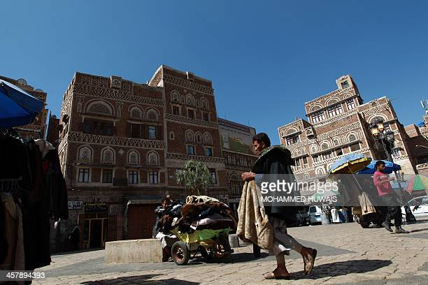Yemenis gather in a market in Sanaa's old city On December 19 2013 AlQaeda in the Arabian Peninsula has stepped up attacks on security forces...