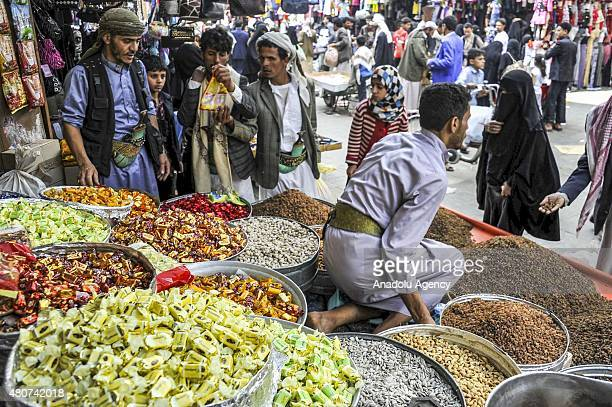Yemenis go shopping to purchase budgetfriendly products ahead of the 'Eid alFitr' also known as 'Ramadan Holiday' as holy month of Ramadan will be...
