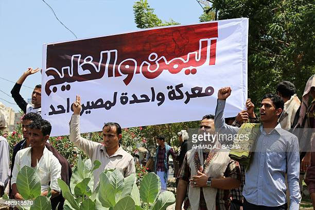 Yemenis hold a banner during a demonstration in support of the Saudiled operation against the Shiite Huthi rebels in the country's thirdlargest city...