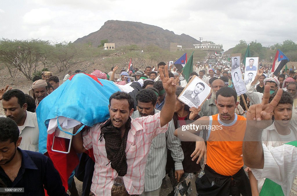 Yemenis hold up posters of Fares Mohammed Ahmed Yafi during his funeral in al-Habilain in southern Yemen, on May 20, 2010. According to local medical sources ,Yafi died from his injuries three days after being shot by security forces on May 16, who were on high alert following a militant attack on a military vehicle the day before in which one soldier was killed and four other were wounded.