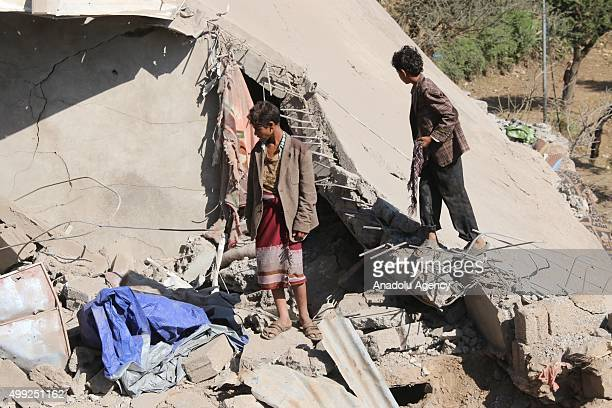 Yemenis inspect collapsed buildings after a Saudiled coalition airstrike targeting residential areas in Sahoul Area of Ibb Yemen on November 30 2015...