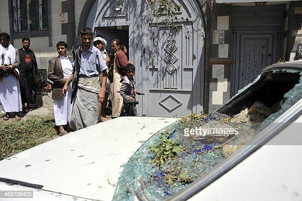 Yemenis inspect the damage after a rocket landed near a house during clashes between rebels and government forces in the capital Sanaa on September...