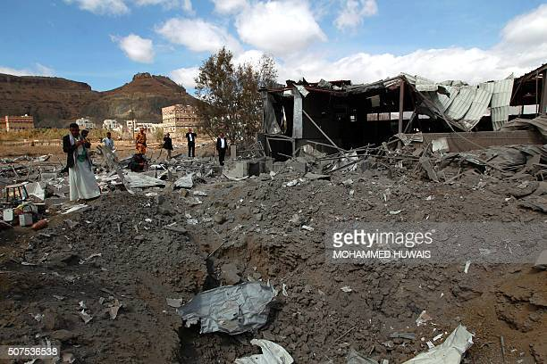Yemenis inspect the damage at the Queen Arwa University following a Saudiled airstrike in the capital Sanaa on January 30 2016 / AFP / MOHAMMED HUWAIS