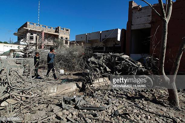 Yemenis inspect the damage following an airstrike by the Saudiled coalition in the capital Sanaa on February 27 2016 / AFP / MOHAMMED HUWAIS