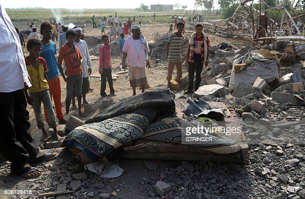 Yemenis inspect the damage in an area near the communications tower reportedly hit by Saudiled coalition air strikes in the port city of Hodeidah on...