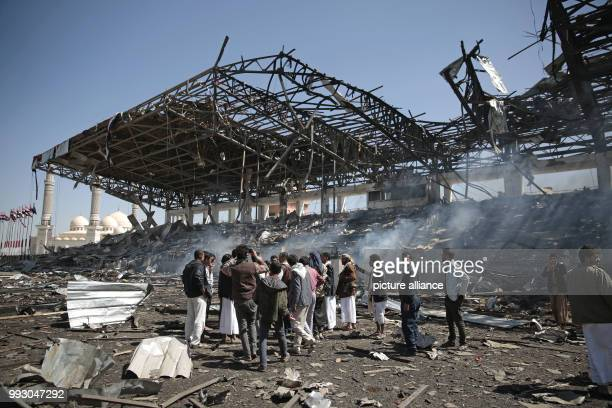 Yemenis inspect the damaged site of an alleged Saudiled airstrike a day after Houthi rebels fired a ballistic missile that was intercepted at the...