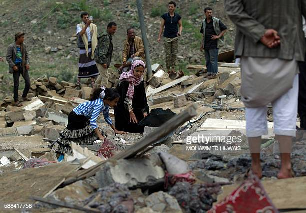 TOPSHOT Yemenis inspect the rubble of a house in Yemen's rebelheld capital Sanaa on August 11 after it was reportedly hit by a Saudiled coalition air...
