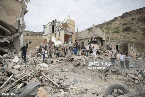 Yemenis inspect the rubble of houses allegedly destroyed by Saudiled airstrikes on Friday morning in Sanaa Yemen 25 August 2017 Photo Hani...