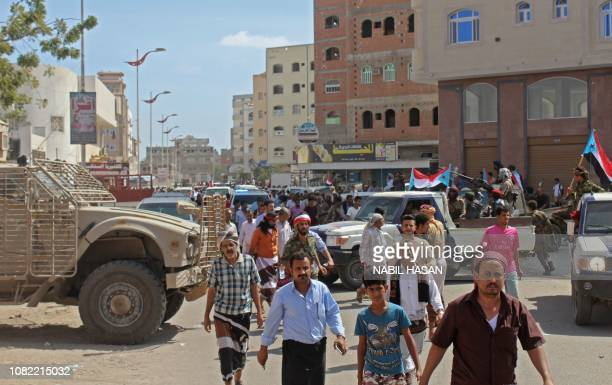 Yemenis make their way to the funeral of Brigadier General Saleh Tamah at the Abu Harba cemetery in the port city of Aden on January 14 2019 Yemeni...