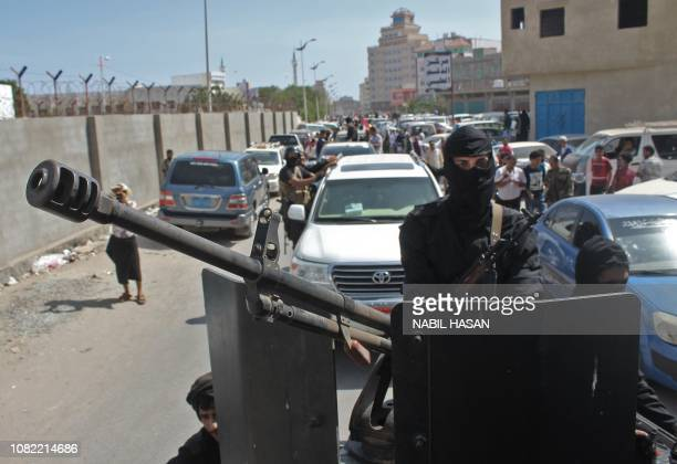 Yemenis military personel and cicilians drive their vehicles during the funeral procession of Brigadier General Saleh Tamah as it makes its way from...