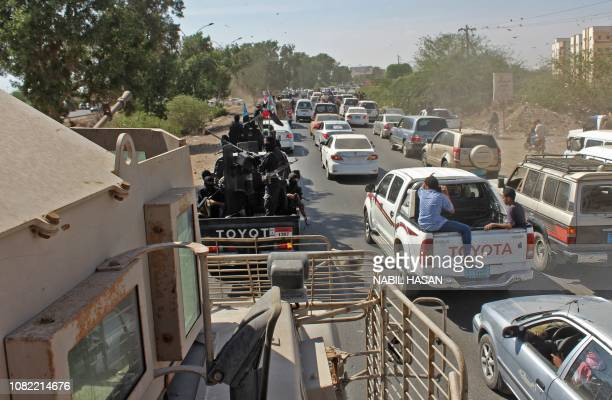 Yemenis military personel and civilians drive their vehicles during the funeral procession of Brigadier General Saleh Tamah as it makes its way from...